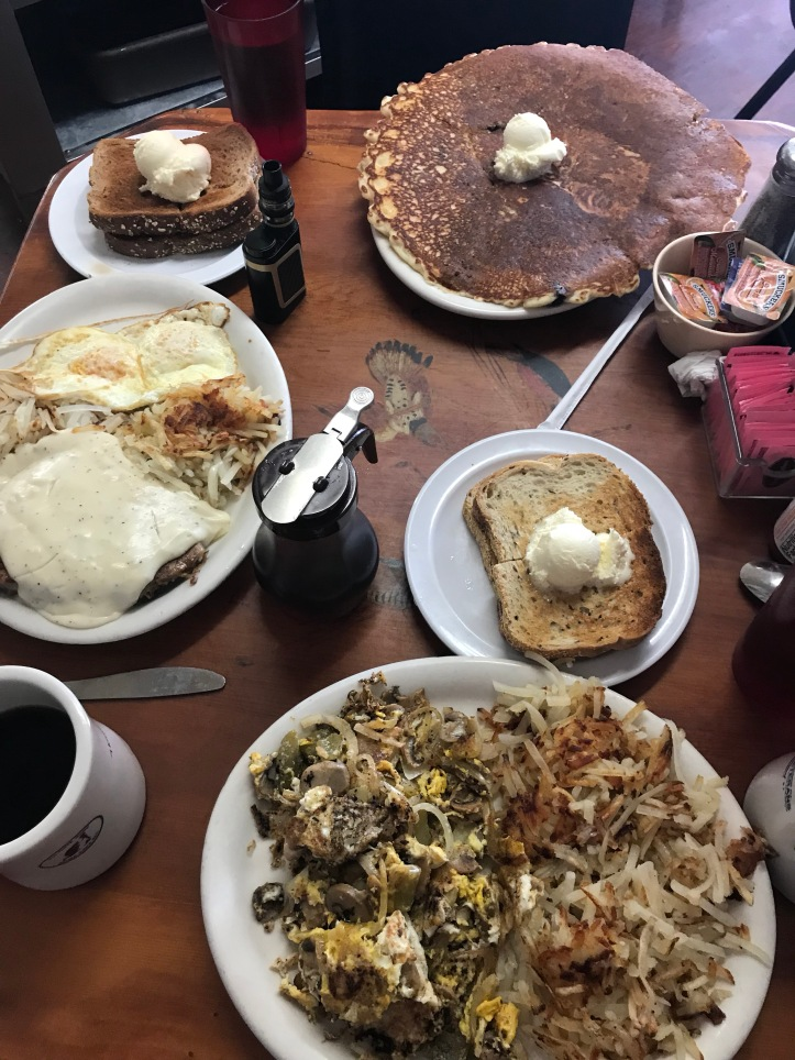 Giant blueberry pancake, chicken fired steak, scramble and hash