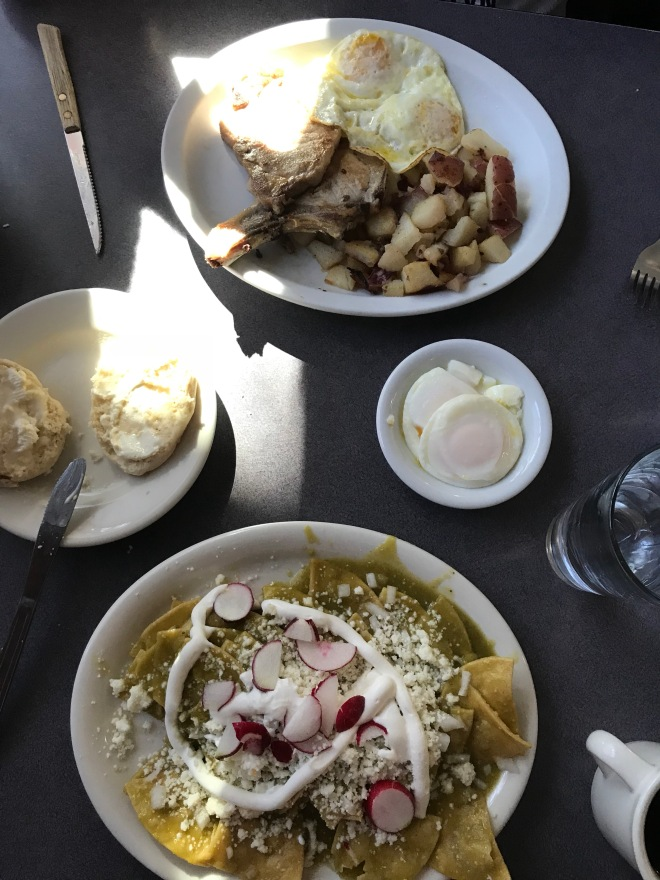 Chilaquiles, pork chops, poached eggs and a biscuit