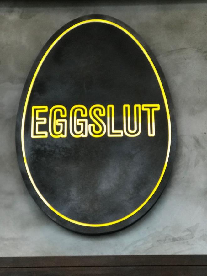 Yellow neon Eggslut logo